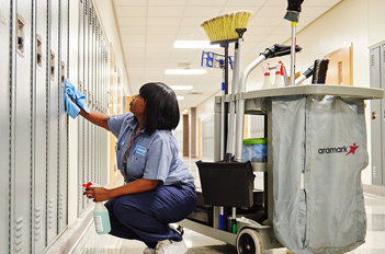 Facilities worker cleaning lockers