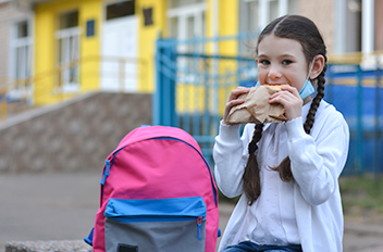 Student eating a sandwich